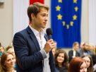 Businessman speaking through microphone during seminar